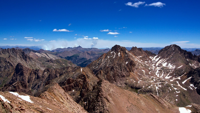 From the summit of North Eolus: a massive wildfire burns in the distant San Juans beyond Sunlight and Windom Peaks.