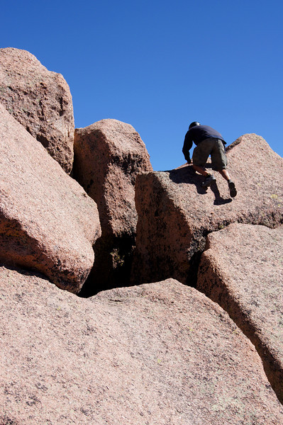 A 4th class  free-climb up the Sunlight summit block; Colorado San Juans.