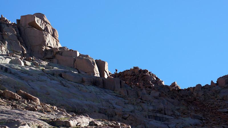 A hiker traverses the southeast ridge of Sunlight Peak, Colorado San Juans.