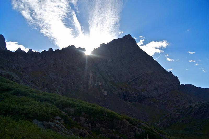 The last rays of sun peek through jagged spires along the southeast ridge of Crestone Needle; Colorado Sangre de Cristo Range.