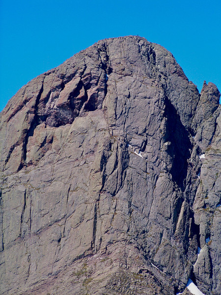 A lone hiker stands on the summit of Crestone Needle; seen from the Humboldt Peak trail.