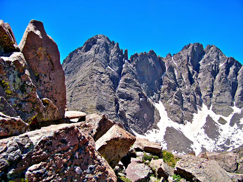 A conglomerate rock formation and the mighty Crestones seen from the Humboldt Peak trail, Colorado