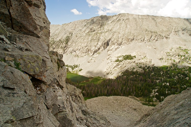 "A peak through a notch leading to a deceptive ""false gully"" above Lake Como; Colorado Sangre de Cristo Range."