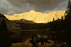 Evening alpenglow illuminates the north face of Little Bear Peak as rain falls on Lake Como; Colorado Sangre de Cristo Range
