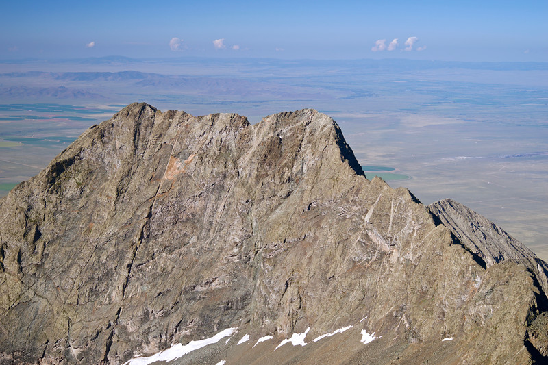 The spectacular sheer east face of Little Bear Peak and the expansive San Luis Valley below, as seen from the summit of Blanca Peak; Colorado Sangre de Cristo Range