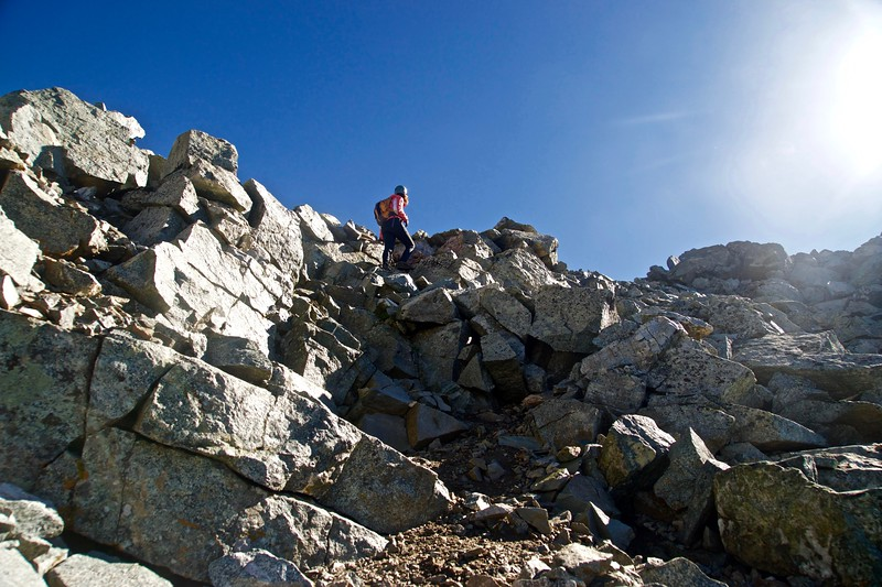 A climber, at 14,000 feet, approaches the coveted summit of Little Bear Peak; Colorado Sangre de Cristo Range