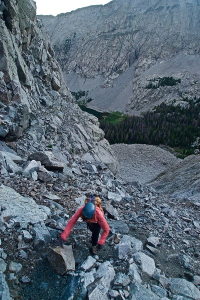 A climber nears the top of the 600 vertical-foot gully on Little Bear's lower north side; Colorado Sangre de Cristo Range