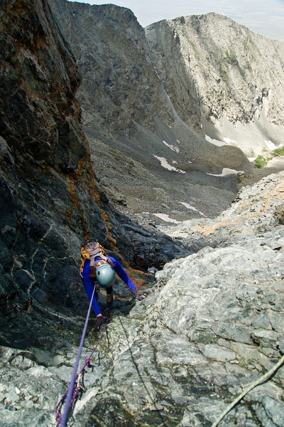 "A belayed downclimb of the treacherous ""hourglass"" gully just below the summit of Little Bear Peak; Colorado Sangre de Cristo Range"