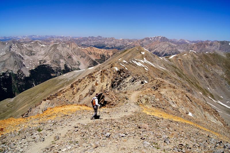 Hikers enjoy spectacular views as they traverse Missouri Mountain's northwest ridge for nearly a mile; Colorado Sawatch Range.