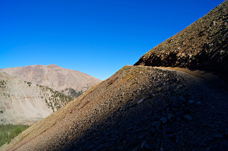 A section of the broad west slope of Mount Antero forms a perfect diagonal line against the deep blue sky; Mt. Princeton is in the background; Colorado Sawatch Range.