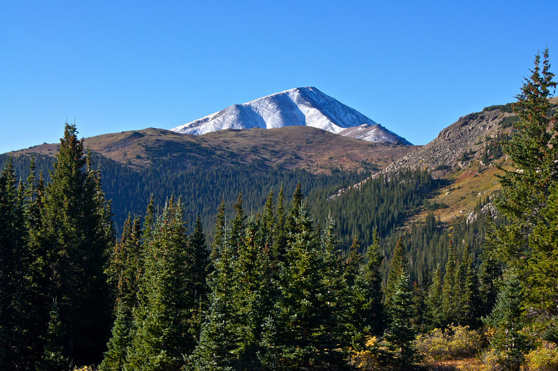 The frost-covered peak of Mount Elbert can be seen briefly along the eastern approach to Mt. Massive;: Colorado Sawatch Range.
