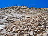 A hiker traverses below the Harvard-Columbia ridgecrest, Colorado Sawatch Range.