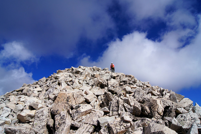 A hiker arrives at the summit of Mt. Princeton; Colorado Sawatch Range.