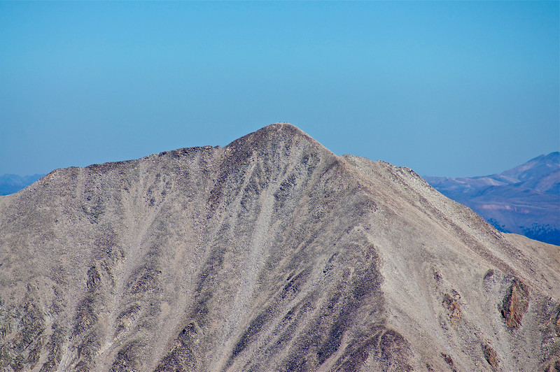 With the help of a telephoto lense, hikers can be seen on the summit of Mount Princeton from Mt. Antero to the south; Colorado Sawatch Range.