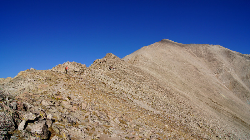 Hikers make their way up the south ridge toward Mt. Princeton's summit; Colorado Sawatch Range.