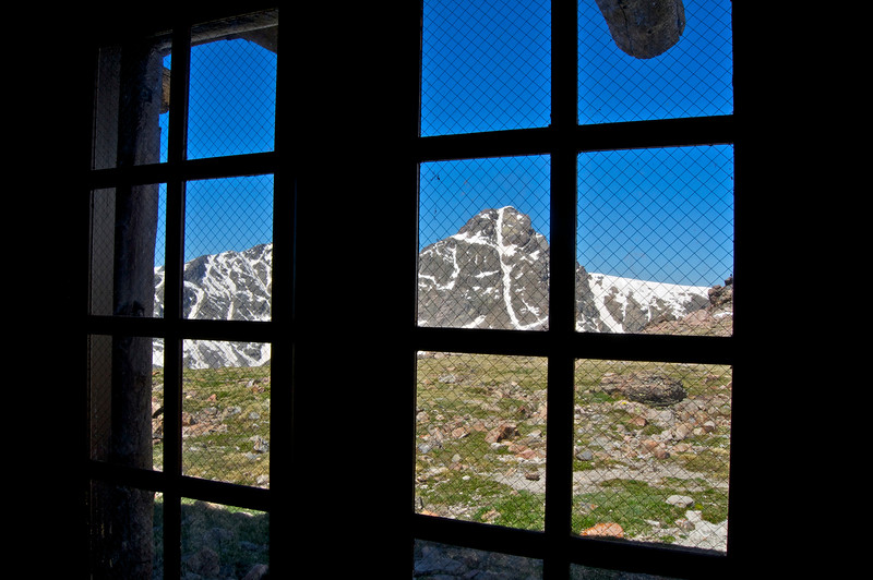 Mount of the Holy Cross viewed from inside the stone hut (13,079 ft.) near the summit of Notch Mountain; Colorado Sawatch Range.
