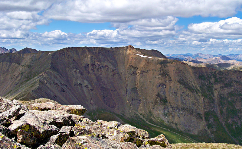 Scattered clouds drift over Mt. Belford, viewed from the summit of Mt. Oxford, Colorado Sawatch Range.