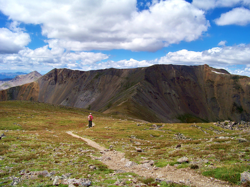 A hiker traverses the ridge from Mt. Oxford to Mt. Belford, Colorado Sawatch Range.