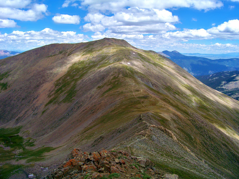 A hiker's trail winds along the gentle southwest ridge to Mt. Oxford, Colorado Sawatch Range