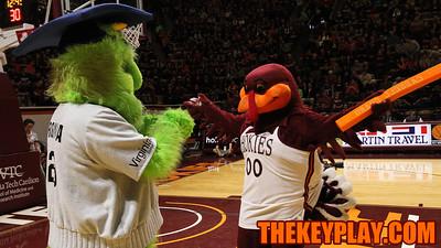 The Hokiebird meets the Virginia 529 monster before the halftime baby race. (Mark Umansky/TheKeyPlay.com)