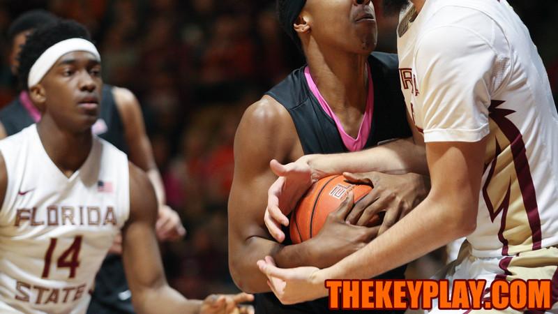 Zach Leday holds onto the ball as FSU's Boris Bojanovsky tries to grab on. (Mark Umansky/TheKeyPlay.com)