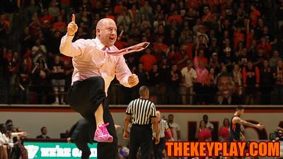 Buzz Williams celebrates a successful charge call on defense. (Mark Umansky/TheKeyPlay.com)