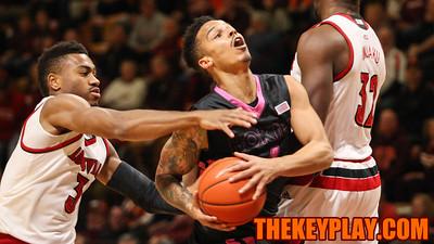 Louisville's Trey Lewis tries to block Seth Allen from behind. (Mark Umansky/TheKeyPlay.com)