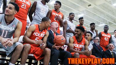 Head coach Buzz Williams (center) has a laugh with Justin Robinson (5) and Jalen Hudson (23) before group photos. (Mark Umansky/TheKeyPlay.com)