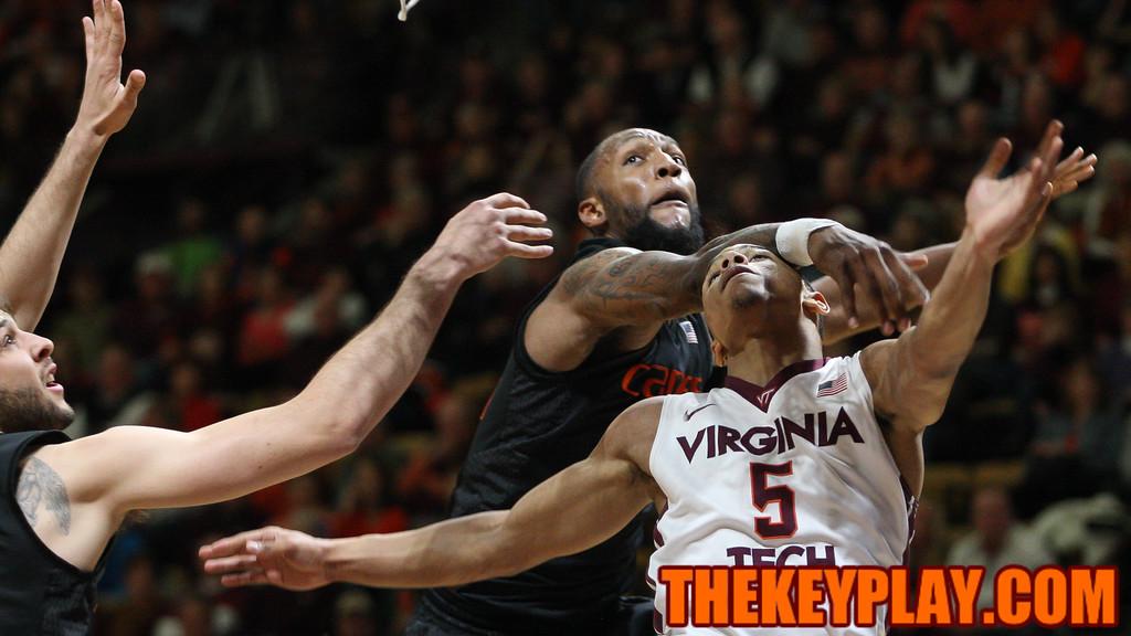 Justin Robinson is fouled on a layup attempt. (Mark Umansky/TheKeyPlay.com)