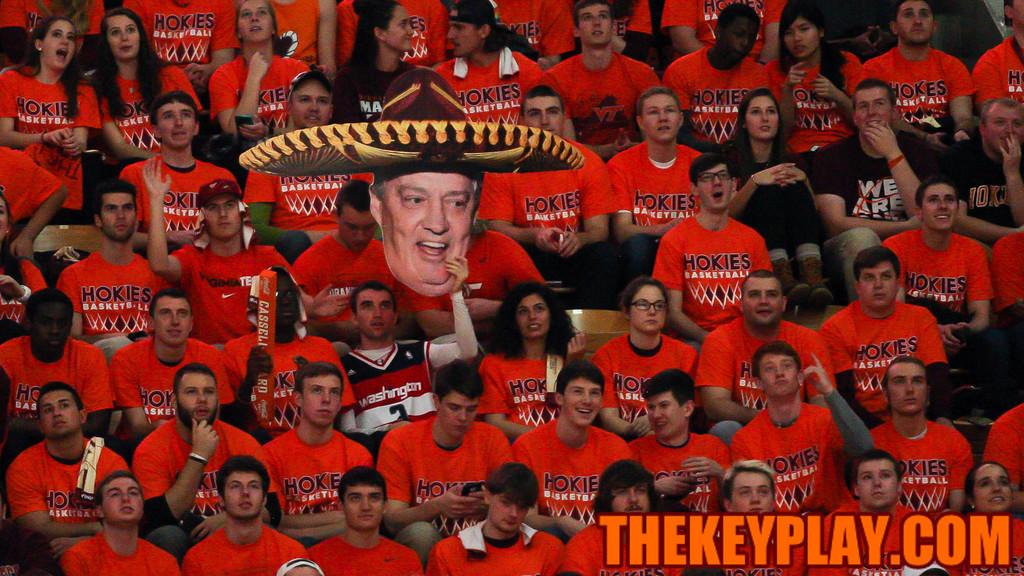 A student holds up a large printout of former Virginia Tech Head Football Coach Frank Beamer. (Mark Umansky/TheKeyPlay.com)