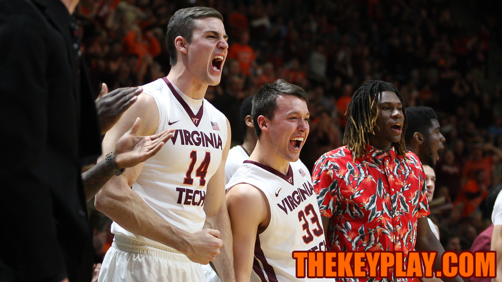 Greg Donlon (left), Matt Galloway (center), and Chris Clarke (right) celebrate a Virginia Tech three-point shot in the second half. (Mark Umansky/TheKeyPlay.com)