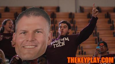 A student holds a fathead of new Virginia Tech Head Football Coach Justin Fuente. (Mark Umansky/TheKeyPlay.com)