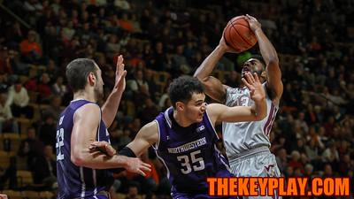Jalen Hudson starts to jump for a layup over Northwestern defenders. (Mark Umansky/TheKeyPlay.com)