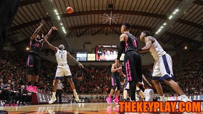 Justin Bibbs (left) attempts a three point shot from the corner. (Mark Umansky/TheKeyPlay.com)