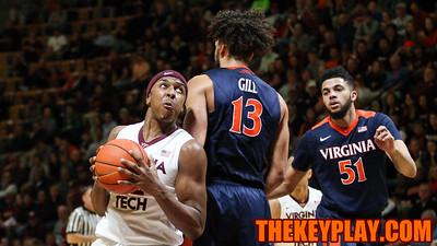 Zach Leday tries to spin around Anthony Gill on  a run to the basket. (Mark Umansky/TheKeyPlay.com)