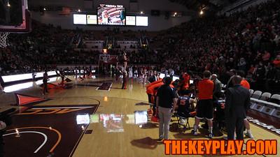 The UVA basketball team huddles during the Virginia Tech starting lineup introductions during pregame. (Mark Umansky/TheKeyPlay.com)