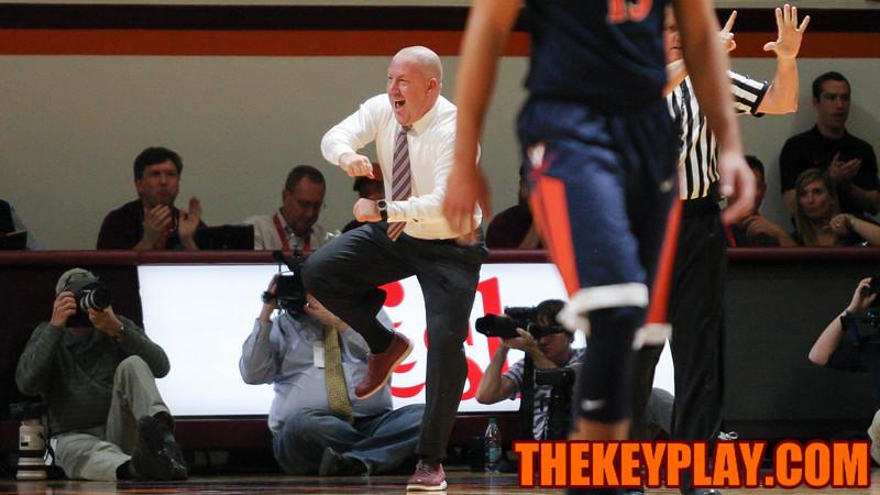 Head coach Buzz Williams celebrates a defensive foul drawn on UVA in the first half. (Mark Umansky/TheKeyPlay.com)
