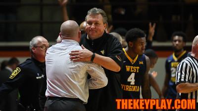West Virginia Head Coach Bob Huggins shakes hands with Buzz Williams after the final whistle. WVU won 88-63. (Mark Umansky/TheKeyPlay.com)