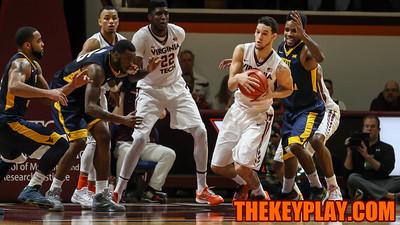 Devin Wilson grabs a rebound after a West Virginia miss. (Mark Umansky/TheKeyPlay.com)