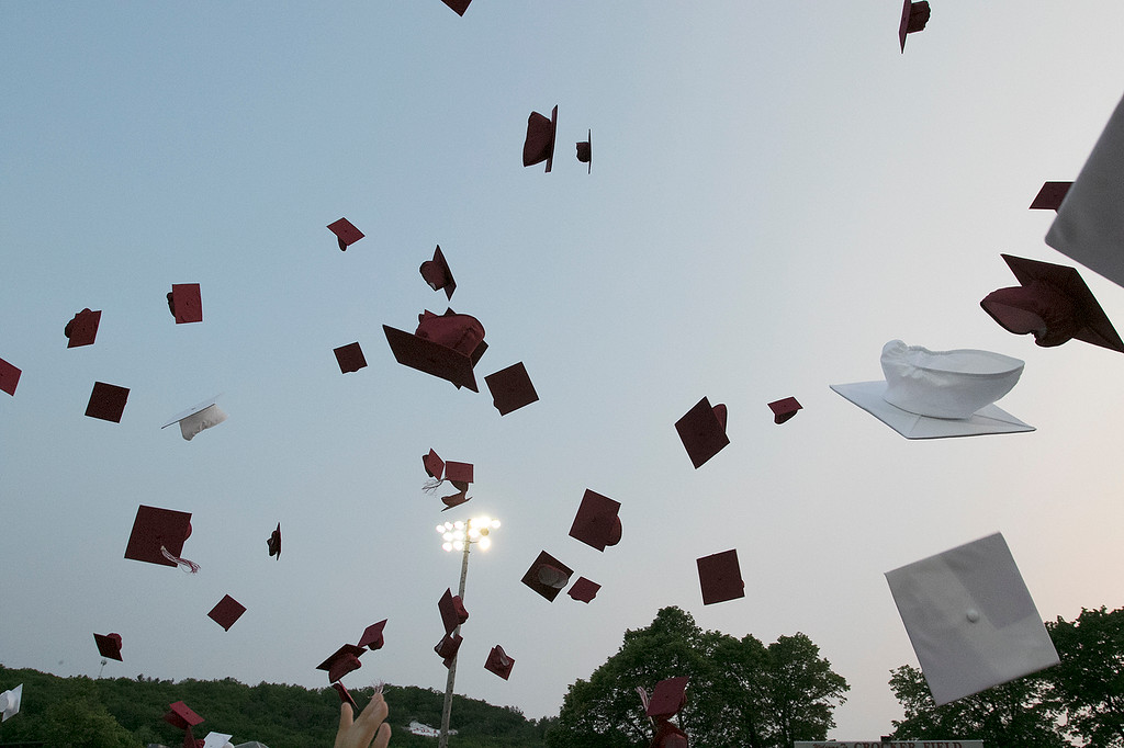 . Fitchburg High School graduation was held at Crocker Field on Friday night, May 31, 2019. Caps fly high aft the end of the graduation. SENTINEL & ENTERPRISE/JOHN LOVE