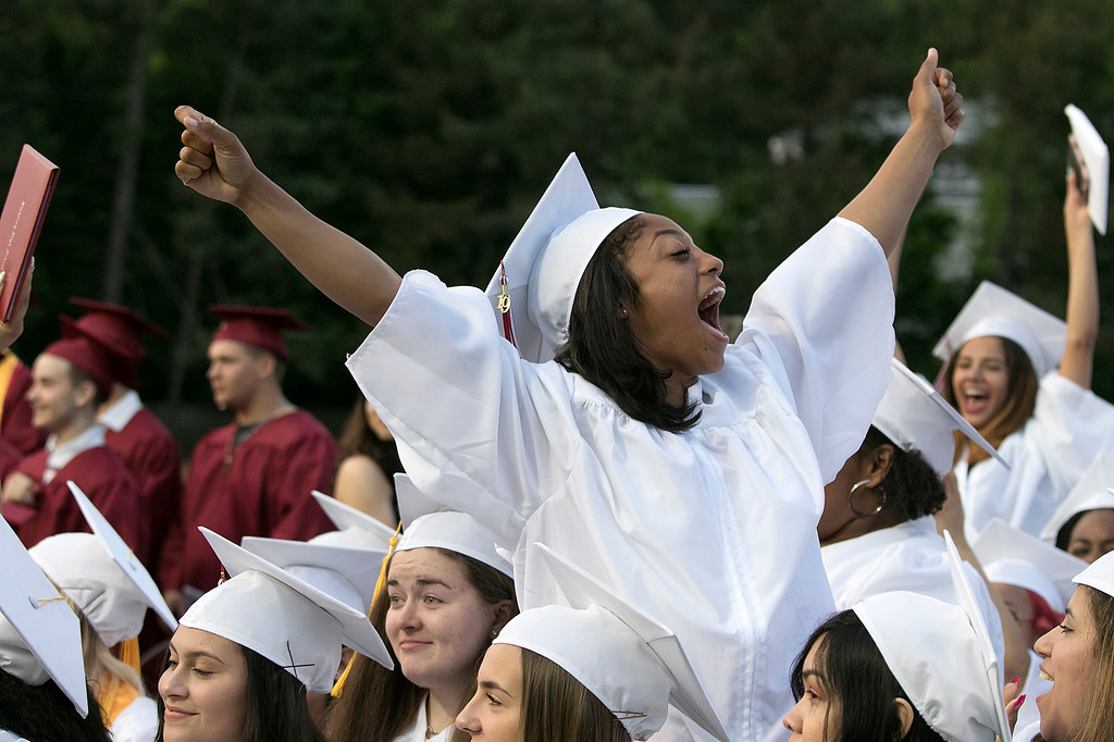 . Fitchburg High School graduation was held at Crocker Field on Friday night, May 31, 2019. Graduate DeAundre Wiggins celebrates with her class after they got their diplomas. SENTINEL & ENTERPRISE/JOHN LOVE