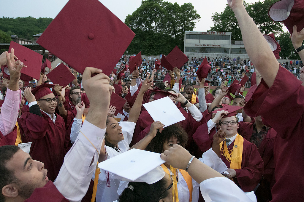 . Fitchburg High School graduation was held at Crocker Field on Friday night, May 31, 2019. Graduate gathered in the center of the field and get ready to toss their caps. SENTINEL & ENTERPRISE/JOHN LOVE