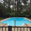 pool, garage and garden beds behind