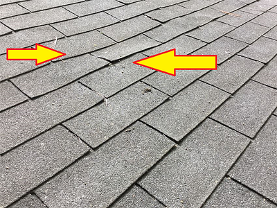 Note the curl on the edges of shingles due to aging beyond their serviceable life.