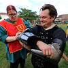 The 15th annual Blacksmith Art and Renaissance Festival was held on Saturday, September 29, 2018. Roberta Edwards from Tewksbury helps Scott Weaver from Marlboro N.H. put on his armor during the festival. They are both with the Knights of Lord Talbot. SENTINEL & ENTERPRISE/JOHN LOVE