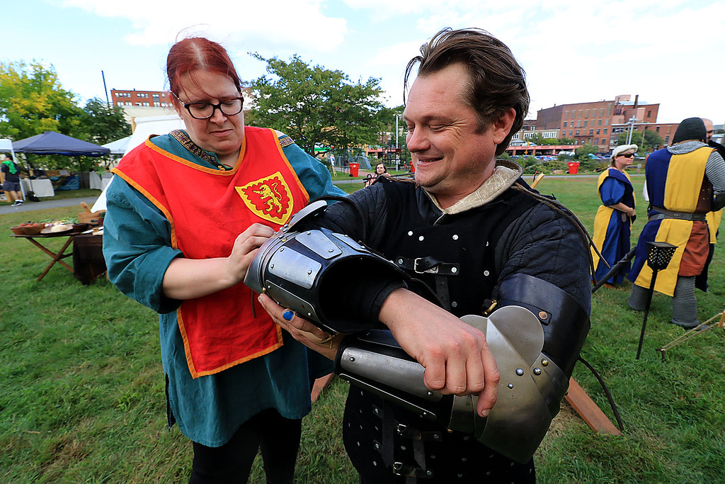 . The 15th annual Blacksmith Art and Renaissance Festival was held on Saturday, September 29, 2018. Roberta Edwards from Tewksbury helps Scott Weaver from Marlboro N.H. put on his armor during the festival. They are both with the Knights of Lord Talbot. SENTINEL & ENTERPRISE/JOHN LOVE