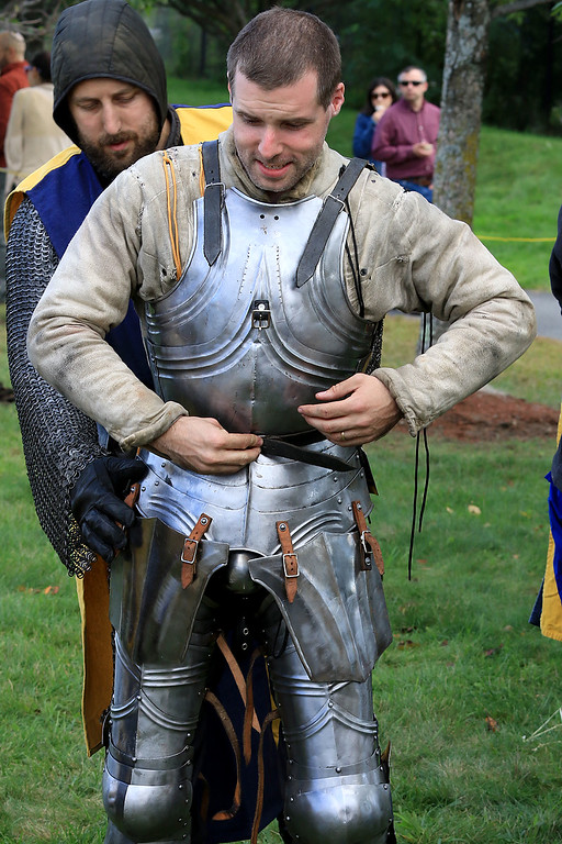 . The 15th annual Blacksmith Art and Renaissance Festival was held on Saturday, September 29, 2018. David Geary of Fitchburg with the Knights of Lord Talbot gets help putting on his full plate from Nicholas LeBlanc from Connecticut.  SENTINEL & ENTERPRISE/JOHN LOVE