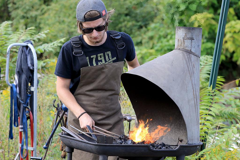 . The 15th annual Blacksmith Art and Renaissance Festival was held on Saturday, September 29, 2018. Bblacksmith David Caruso of Ashburnham heats up some metal during the festival. SENTINEL & ENTERPRISE/JOHN LOVE