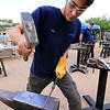 The 15th annual Blacksmith Art and Renaissance Festival was held on Saturday, September 29, 2018. Elan Cannon, 17, with Assabet Valley Regional Technical High School molds some heated metal during the festival. SENTINEL & ENTERPRISE/JOHN LOVE