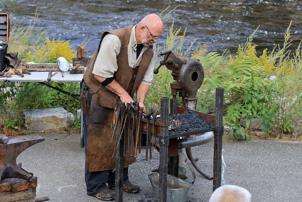 . The 15th annual Blacksmith Art and Renaissance Festival was held on Saturday, September 29, 2018. Blacksmith Dirk Underwood of Hudson heats up some meal during the festival. SENTINEL & ENTERPRISE/JOHN LOVE